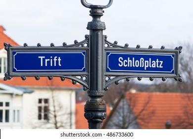 Ballenstedt in Germany, road sign with Trift and Schlossplatz, translation: castle square