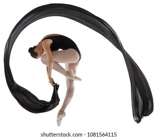 Ballerina with black cloth standing on one leg isolated on white background. Studio photography.