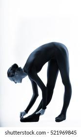 ballerina in a black jumpsuit