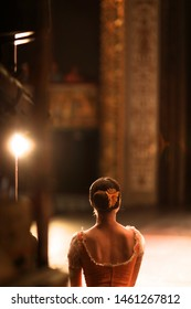 Ballerina in costume is standing backstage, waiting for the stage
