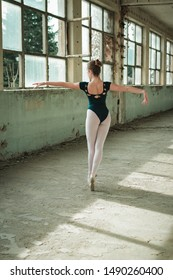 Ballerina dancing in an old building. Young, elegant, graceful woman ballet dancer. Toe walking, technique