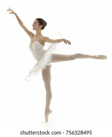 ballerina doing a arabesqu...tu on white background