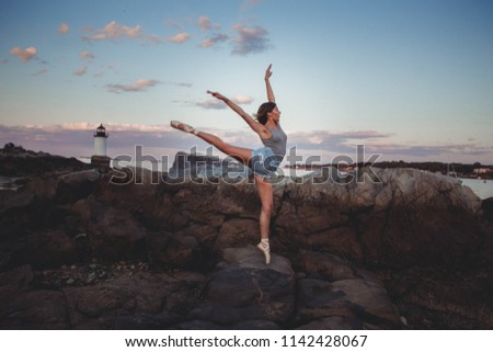 cac73433b ... Stock Photo (Edit Now) 1142428067 - Shutterstock. Ballerina Doing Pointe  on Rocks at the Beach at Sunset