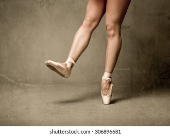 ballerina feet close up while on point, vintage style