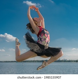 Ballerina Jumping over the Water