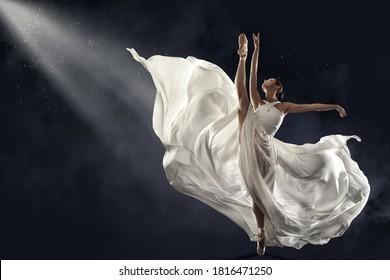 Ballerina Jumping in White Silk Dress, Modern Ballet Dancer in Pointe Shoes, Fluttering Waving Cloth, Gray Background