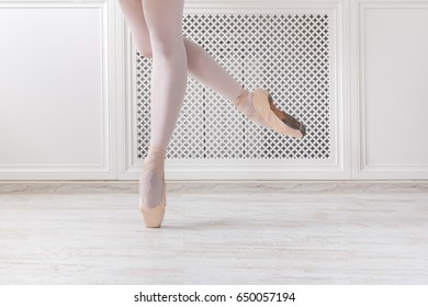 Ballerina legs on pointe, ballet dancer concept background