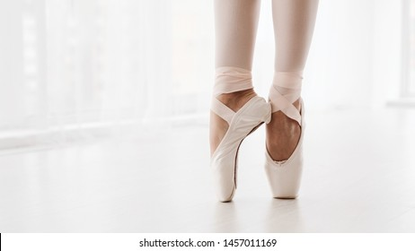 Ballerina Legs On Pointe Shoes Closeup On White Background. Classic And Modern Ballet Concept With Copy Space. Crop, Panorama