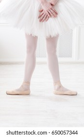 Ballerina legs second position in pointe, ballet dancer concept background, vertical image