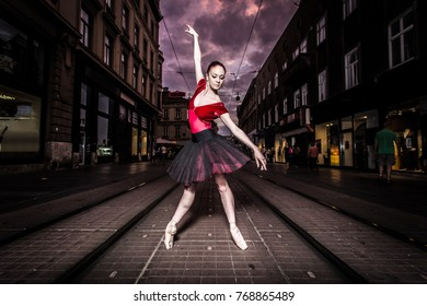 Ballerina Natalia Horsnell in a dance posture in the main street of Zagreb, Croatia.