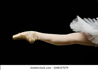 ballerina on point shoes feet tutu on black background isolated