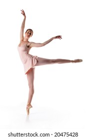 Ballerina performing a dance against a white background