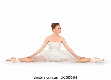 the ballerina in point shoes and a dress dances on a white background