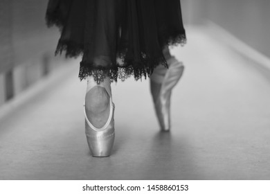 Ballerina in pointe and black lace dress at the theater