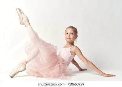 ballerina in pointes pulls a leg, streamer, swan lake, theater