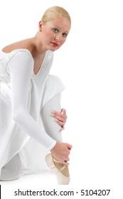 Ballerina posing before performing on white background