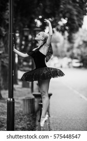 Ballerina posing in the center city on the camra