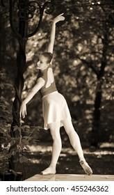 ballerina in red in summer Park