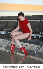 ballerina in red swimsuit at the airport