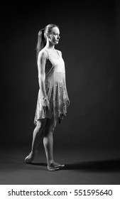 ballerina in a simple dress on a black background