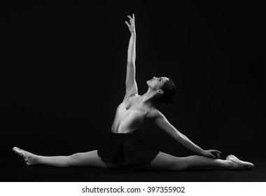 Ballerina sitting on the splits .Grayscale image.