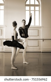 ballerina and soloist of the ballet in the rehearsal hall where the rehearsal