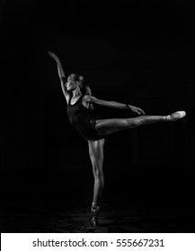 Ballerina in a studio on a black background
