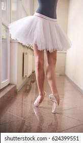 Ballerina in tutu with beautiful feet