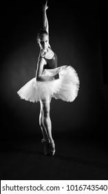 Ballerina in tutu on a black background
