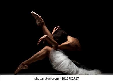 ballerina with a tutu posing on the floor