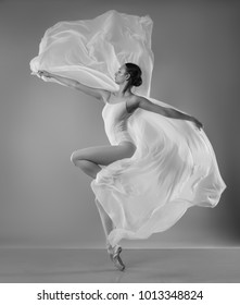 Ballerina in white body with white flying cloth