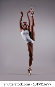 A ballerina in a white leotard