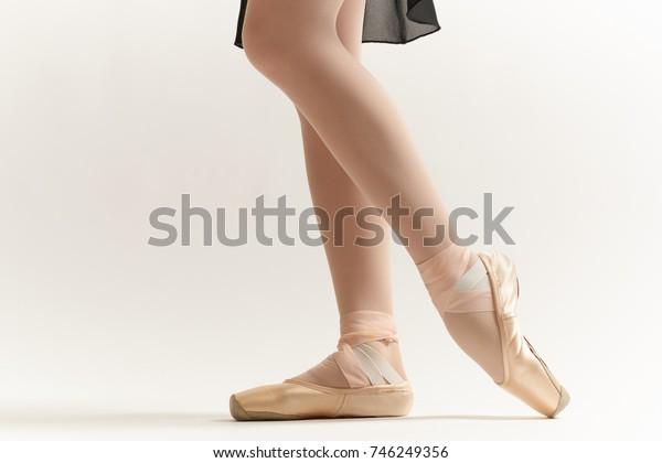 ballerina's feet on a light background