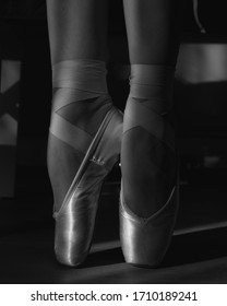Ballerina's feet in Pointe shoes. close up.