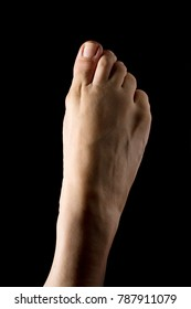 Ballerina's foot close up isolated on black background