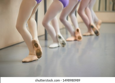 Ballerinas legs practicing at ballet hall. Legs of young ballerina while training in the ballet class.