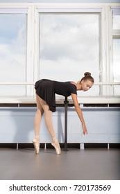 Ballet class, girl ballerina doing exercises
