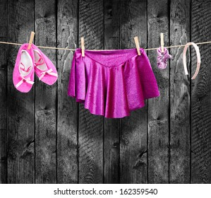 Ballet clothes, accessories on a clothesline