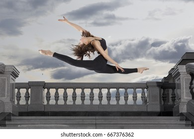 Ballet dancer in black body series on sky background