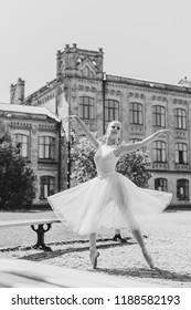 Ballet dancer dancing in the city park. Sensual ballerina in nature. Ballerina on the streets. Ballerina out of doors, young modern ballet dancer posing
