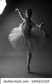 ballet dancer dancing with tutu in studio background