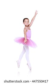 ballet dancer girl in pink pointe and tutu isolated on white, little balerina in quatrieme devant pose. Facing directly front working foot pointing to the front fourth position croisee