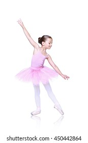 ballet dancer girl in pink pointe and tutu isolated on white, little balerina with working foot pointing to front in second position. Education lessons in Classic dance school