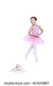 ballet dancer girl in pink pointe and tutu isolated on white, little ballerina with working foot pointing to front in second position. Education lessons in Classic dance school