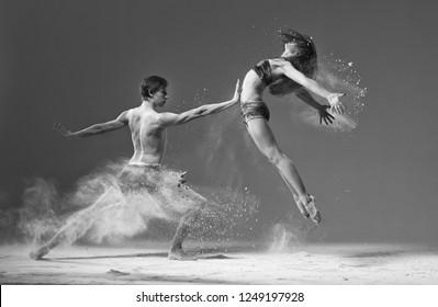 ballet dancer jumping with flour monochrome