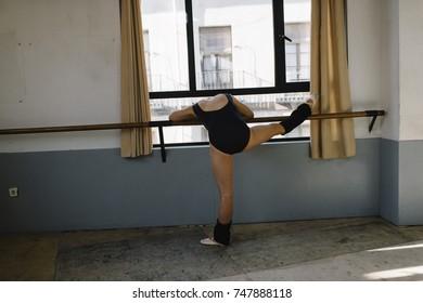 Ballet dancer practicing indoors.