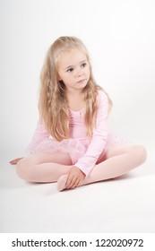 Ballet dancer sitting on the floor