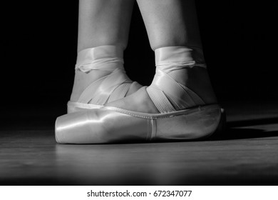 Ballet dancer's beautiful feet with pointe shoes