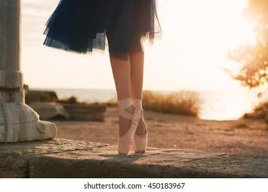 Ballet dancer's feet on sunset. Ballet shoes.