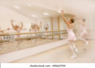 Ballet dancers, young ballerina dancing in front of mirror. Training hall background. soft focus, blurry image